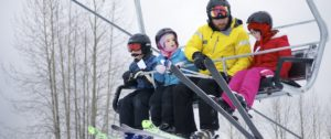A family on a chair lift